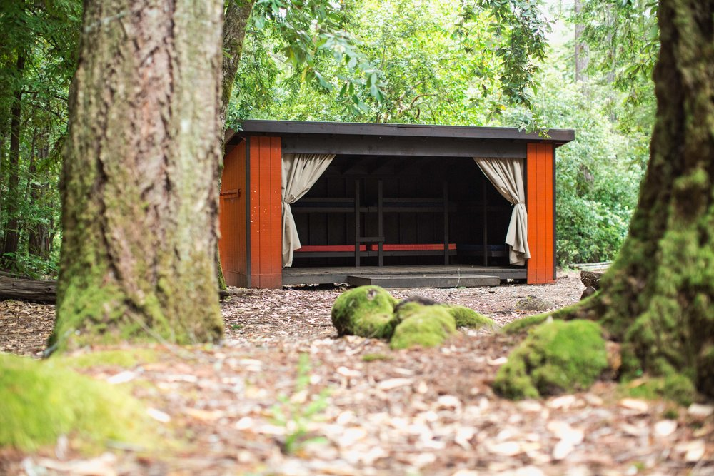 Adirondack Cabin - The Adirondacks are equipped with four bunk beds. They have large canvas curtains that act as a door and fourth wall. There are groupings of 2-5 Adirondack cabins around the site (see map). Each group is set up to be a small village - get together with friends/family to set up your encampment.$150.00