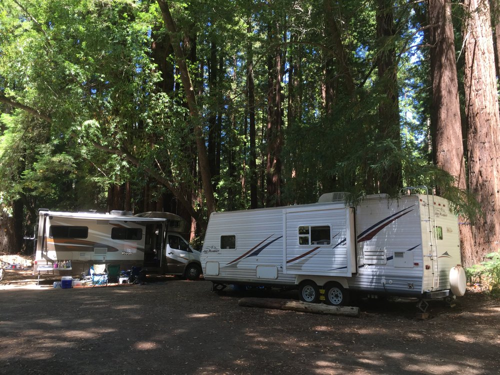 RV/Car Camping - Camp Navarro has an RV zone that can fit up to 16 RV or Vanagon type vehicles. There are 8 sites that have electrical hookups available on a first come first served basis. All other sites are just open spots in this redwood grove. There are no other hookups, septic, or other facilities. The main bathroom/shower house is about fifty yards away. $0