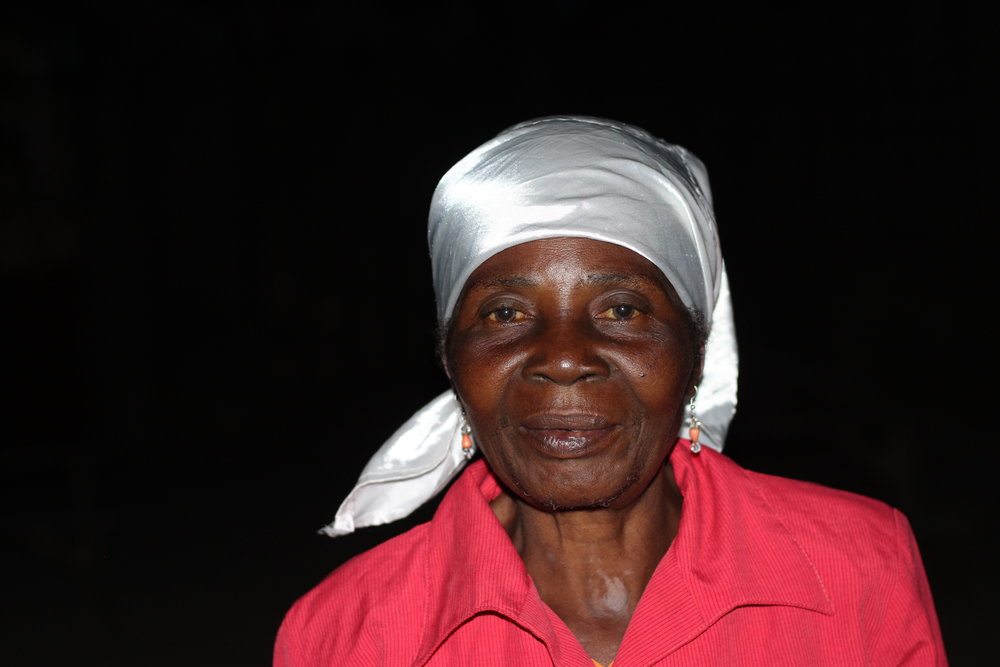 "Carmen Sharle - 45 years old""My husband passed away last year, so I am by myself with seven children, who are all young adults but still in school in Chermaitre. I work the field, sell beans and peanuts in the market, but I still don't have enough money. """