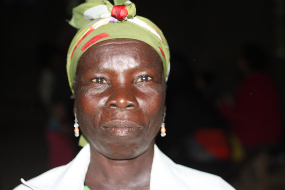 "Edwa Olain - 40 years old""My husband has passed away so the entire family's responsibility is on me. But sometimes I cannot do the things that are supposed to be done by a man. I want to build a bigger house but I don't know how. When the church gave out cement and tin roofs, I didn't get any."""