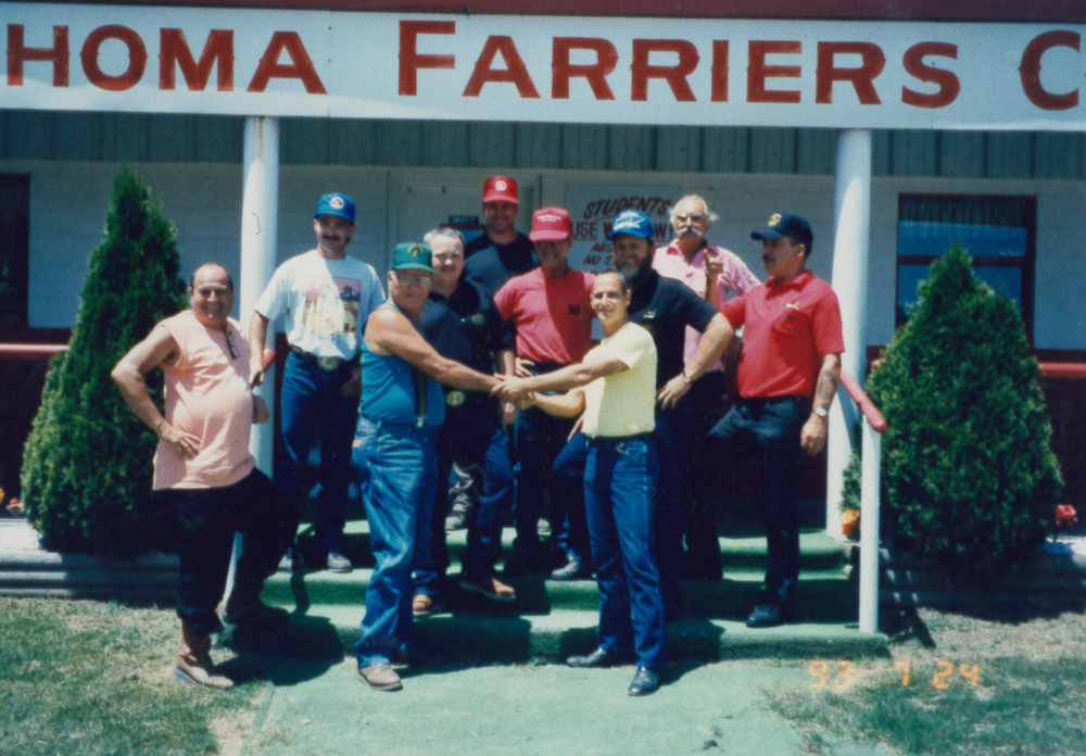 Bud Beaston front left in blue, shaking hands. 1990, Cross Country Tour