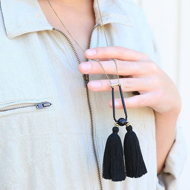 Our Amira necklace comes in a variety of colors and features jade, brass and glass beads, two tassels, raw brass chain and gold-filled clasp. Available in black, forest, red, rose, cream or rust tassels. On sale $65 (original price $118). . . . #fall #fashion #style #tassels #necklace #jewelry #gold #jade #brass #sale #fallsale #btlabus #shopbtla #beautifulthings #beautifulthingsla #accessories