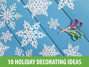 Festive up your home — both indoors and out — with these 10 easy-to-create Christmas decorations, crafts and centerpieces.   1) Make Ice Lanterns  Get an assist from Mother Nature (or your freezer) to turn plastic cartons filled with water into magical ice lanterns to display either indoors or out.  Make your own with these tips .   2) Glow It On   This how-to  explains how to create these illuminated grapevine sphere topiaries for your front porch. The waterproof lights ensure they'll brighten up your entry even during stormy winter weather.   3) Fake a Roaring Fireplace  Apartment dwellers and urbanites: this project's for you. Get creative to craft a spot to hang your stockings and lend a little Christmas cheer to any room. Our  step-by-step instructions  show you how to turn a canvas dropcloth, drapery hardware and chalkboard paint into this clever faux mantel wall hanging that you can simply roll up and store when the holidays are over.   4) Craft an Upholstered Banner  Cheerfully issue a Christmas greeting to all who enter your home with this  DIY upholstered holiday banner . Swap out the letters to easily craft more banners for birthdays, Thanksgiving, Halloween, Easter or any other occasion worth celebrating.   5) Fold a Mini Forest  Use a circle punch or scissors to cut card stock into various size circles, then accordion-fold the paper to create the look of swagging evergreen boughs. Stack the folded rings and attach to a small wood dowel or cut log slice to easily whip up a whole forest of firs.   6) Make 3-D Upholstered Trees  Basic upholstery materials and techniques are all you need to craft these fabric-covered trees that fold flat so they're a cinch to store between holidays. Learn how to make your own with these  step-by-step instructions .   7) Add Some Sparkle  These gorgeous, glittering votives only look expensive. Using glitter, glue and an empty jar, you can easily  craft them yourself  on the cheap.   8) Wintry Blooms  Create a floral centerpiece that incorporates warm holiday hues and that will instantly liven up your dinner table.  Brittni Mehlhoff  arranges various red flowers, berries and succulents in a rustic wicker basket. (You can choose any vase that suits your style.) Use floral wire to tame stubborn stems and plants, add pinecones around the base and you're ready to host for the holidays.   9) Craft a Snowy Wreath  Add faux greenery, flowers, berry sprigs and glittered pinecones to a grapevine wreath then cover with faux snow to give your front door a cheery update during winter months.  Learn how to make your own .   10) Restaurant-Style Menu Board  Let your guests know exactly what's for dinner with a restaurant-style menu board made from a DIY chalkboard. For more seasonal and sophisticated flair, apply gold leaf to a large wooden frame. Guests will never know how easy and inexpensive this was to make. Design by  Marian Parsons . Make your own with these  step-by-step instructions .