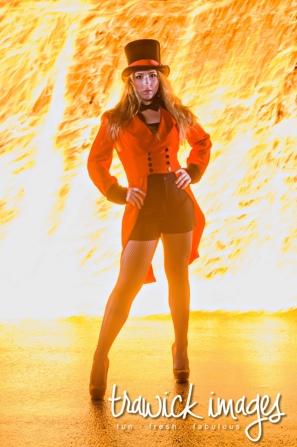 Avery rocking a pose while feeling the real heat from the Wall of Fire background.