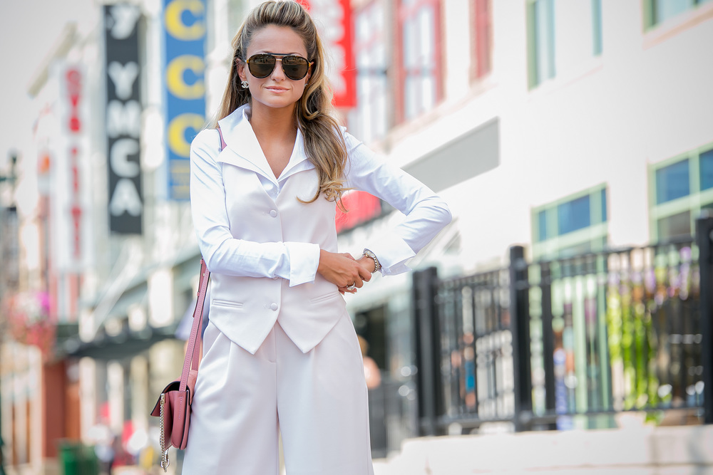 streetstyle blogger Lauren Recchia. She is wearing a blouse by Anne Fontaine, pink set from Asos, and Marc Jacobs sunglasses.