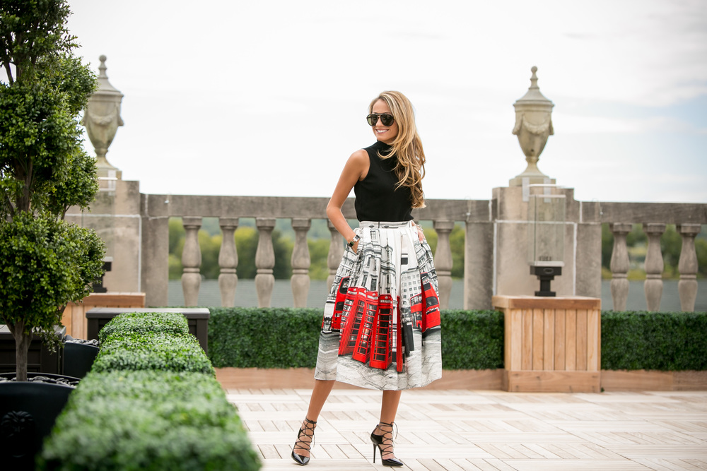 Lauren Recchia wearing London midi-skirt, Milly mock neck top, and Jimmy Choo lace up pumps