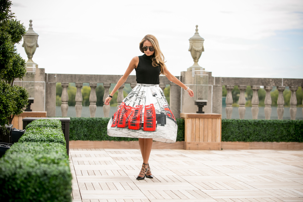 Lauren Recchia from www.northofmanhattan.com twirling in London midi-skirt