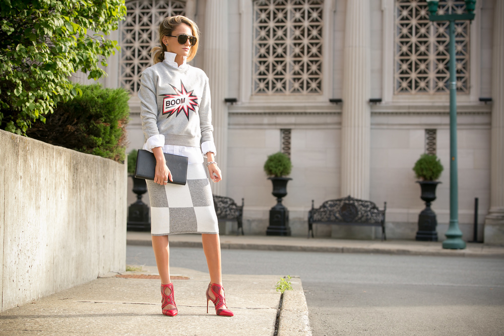 Lauren Recchia street style wearing MSGM sweatshirt, Derek Lam knit skirt, and Alexandre Birman red pumps