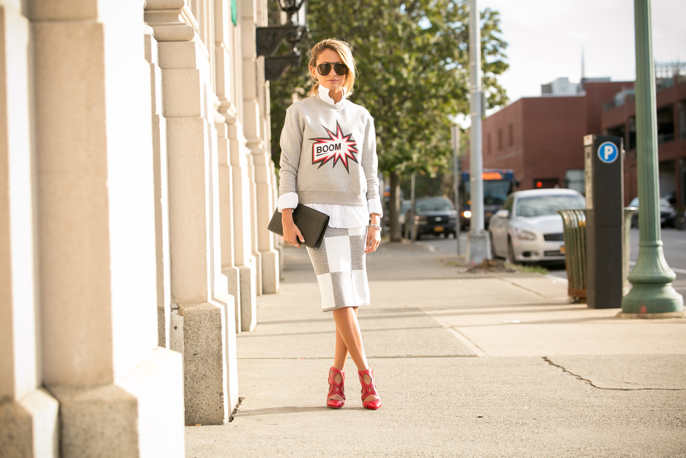 Lauren Recchia from North of Manhattan seen in graphic sweatshirt by MSGM, Derek Lam knit skirt, Alexandre Birman red pumps, and a YSL black clutch