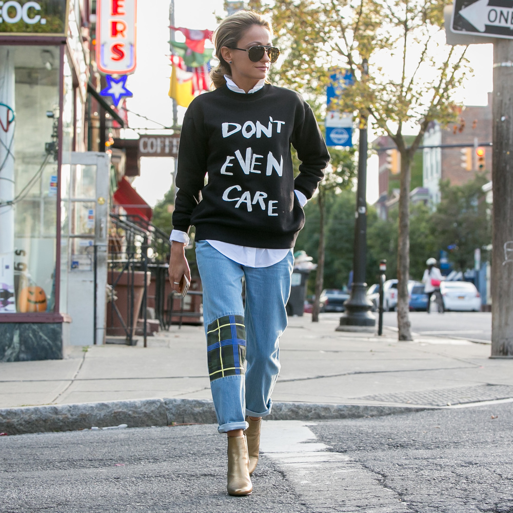 Fashion blogger from North of Manhattan wearing Etre Cecile graphic sweatshirt and patchwork boyfriend jeans