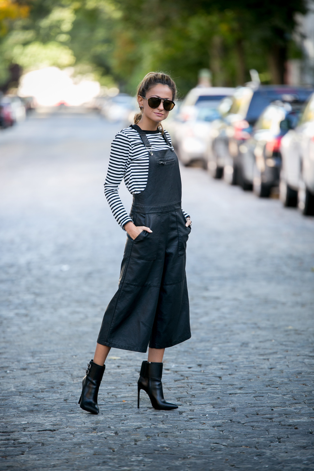 streetstyle blogger wearing striped long sleeve top and faux leather overalls from TopShop and Saint Laurent Boots