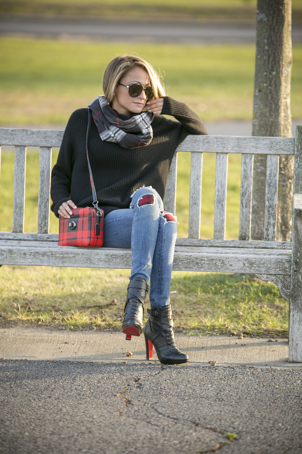 streetstyle by Lauren Recchia wearing Vince cashmere sweater, Rag & Bone patched jeans, Christian Louboutin boots, and Coach plaid bag