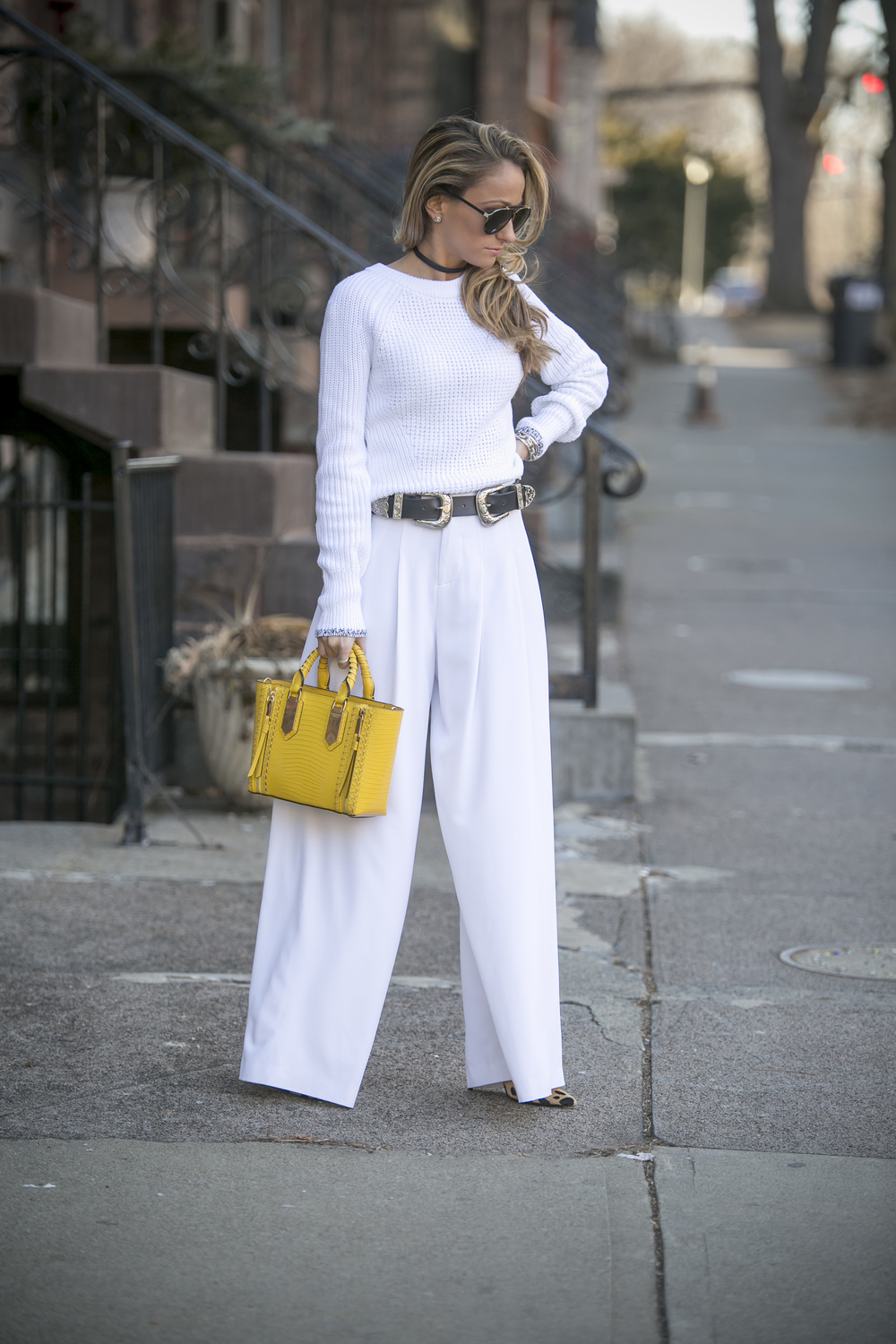 streetstyle blogger wearing Rag and Bone sweater, Alice and Olivia pants, Henri Bendel Bag, and B-low the belt