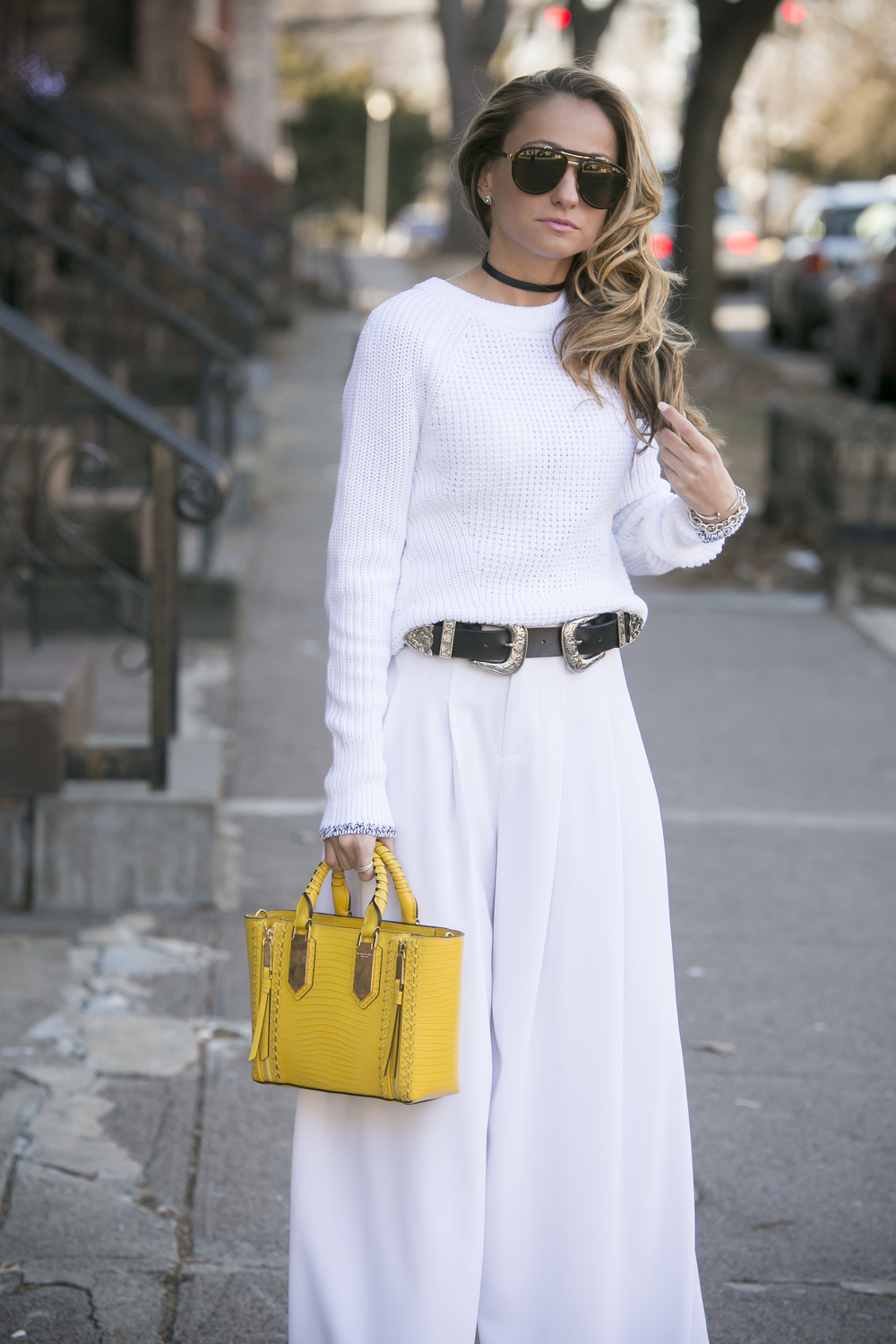 North of Manhattan wearing B-low the belt, and Henri Bendel yellow bag with an all white outfit
