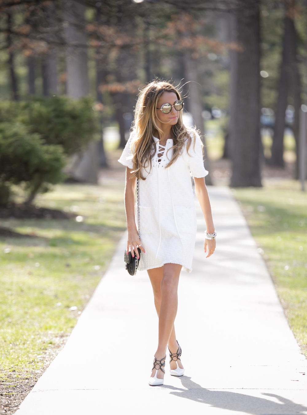 The little white dress worn with Christian Louboutin pumps