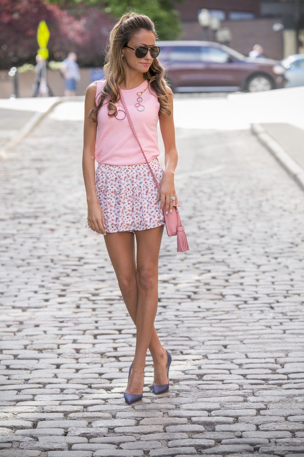 north of manhattan seen in floral shorts and Rebecca Minkoff accessories