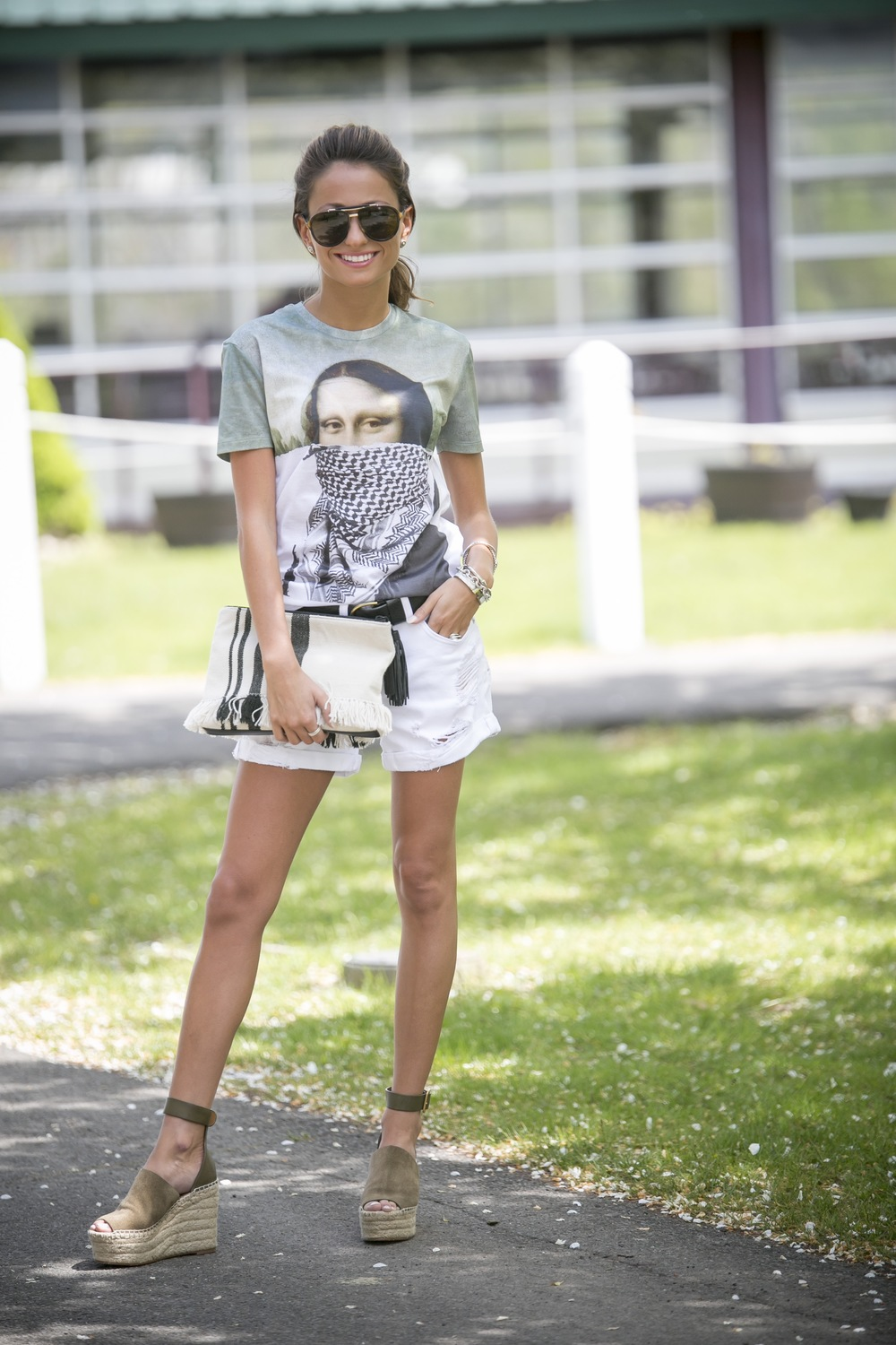 casual summer streetstyle from north of manhattan in a graphic tee, white denim shorts, and chloe wedges