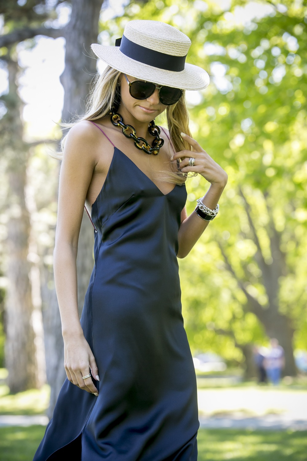 Lauren Recchia seen in a Rag and Bone black silk dress paired with a Eugenia Kim boater hat and a chunky Kenneth Jay Lane necklace from Intermix Online