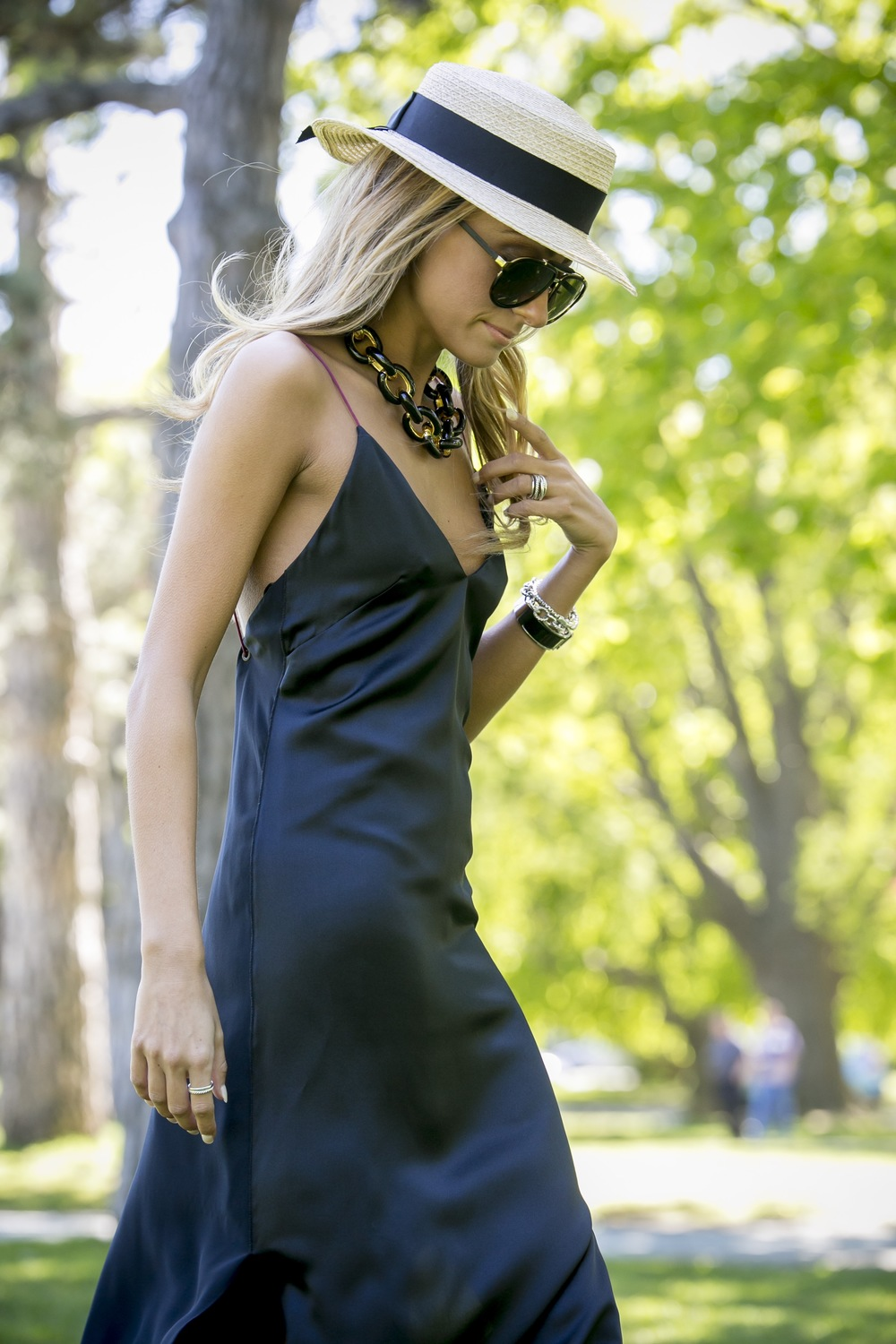 Eugenia Kim boater hat and silk slip dress seen on Lauren Recchia the founder of the NYC based fashion blog North of Manhattan