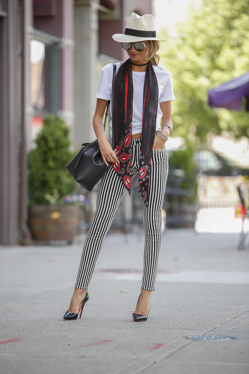 J.Crew fedora, Rockins skinny scarf, white tee, Rag and Bone jeans, Christian Louboutin pumps, and Mansur Gavriel bag seen on streetstyle blogger Lauren Recchia from North of Manhattan