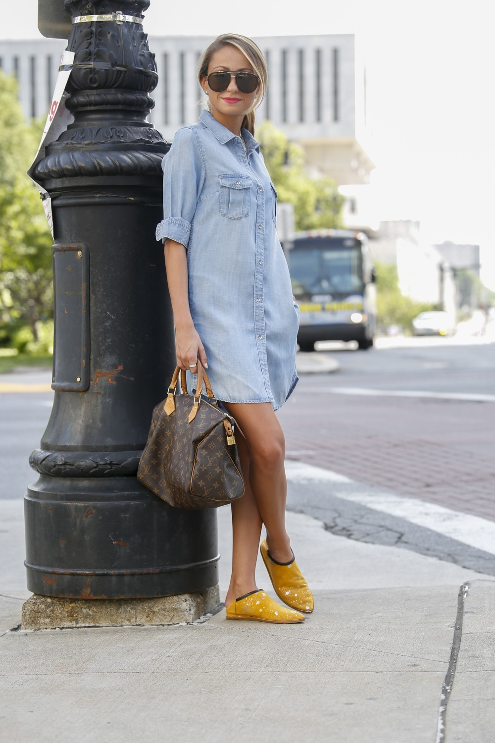 Fashion blogger north of manhattan seen wearing a chambray dress with Georgina Goodman slippers and Louis Vuitton speedy bag