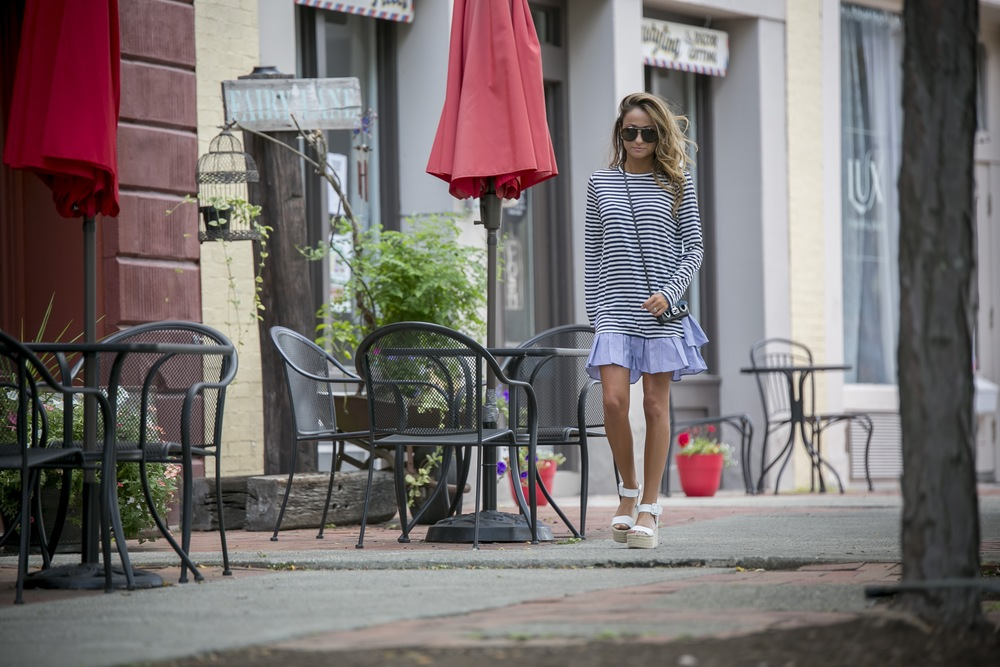 striped tee dress finished with a ruffle hem, worn with espadrilles and a mini Fendi baguette bag