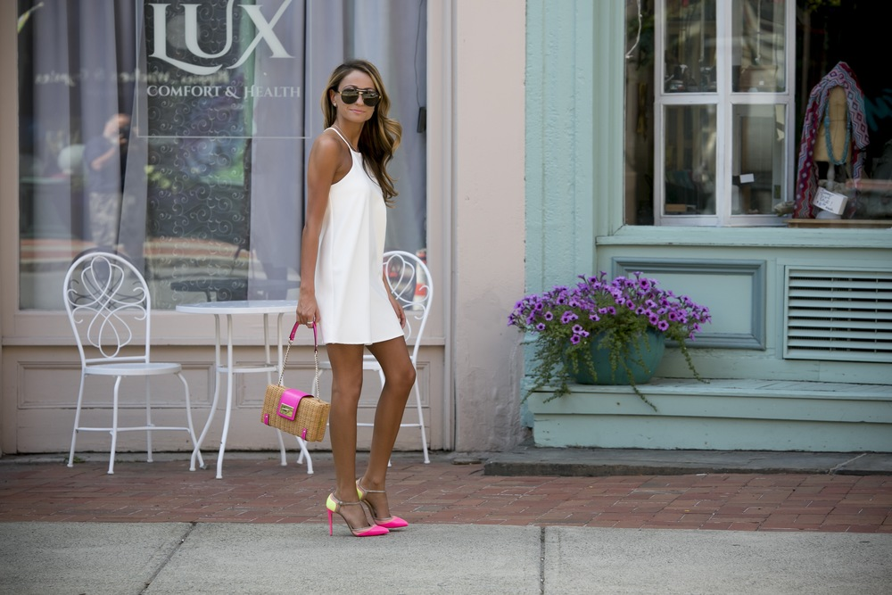 fashion blogger north of manhattan in a just one answer little white dress and christian louboutin pumps