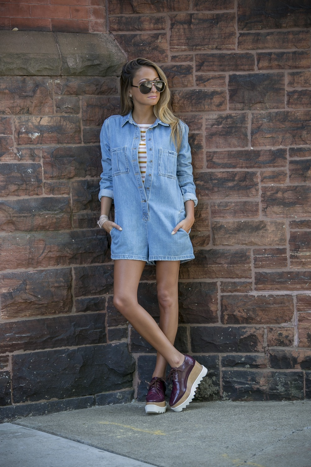 Stella McCartney platforms worn with a denim romper layered with a striped tee