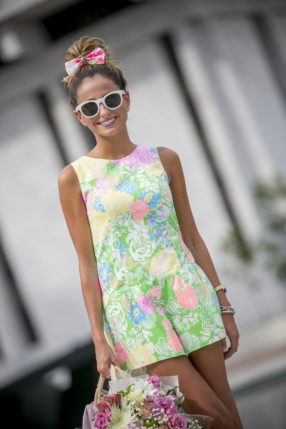 Lilly pulitzer hair bow and romper paired with white sunglasses