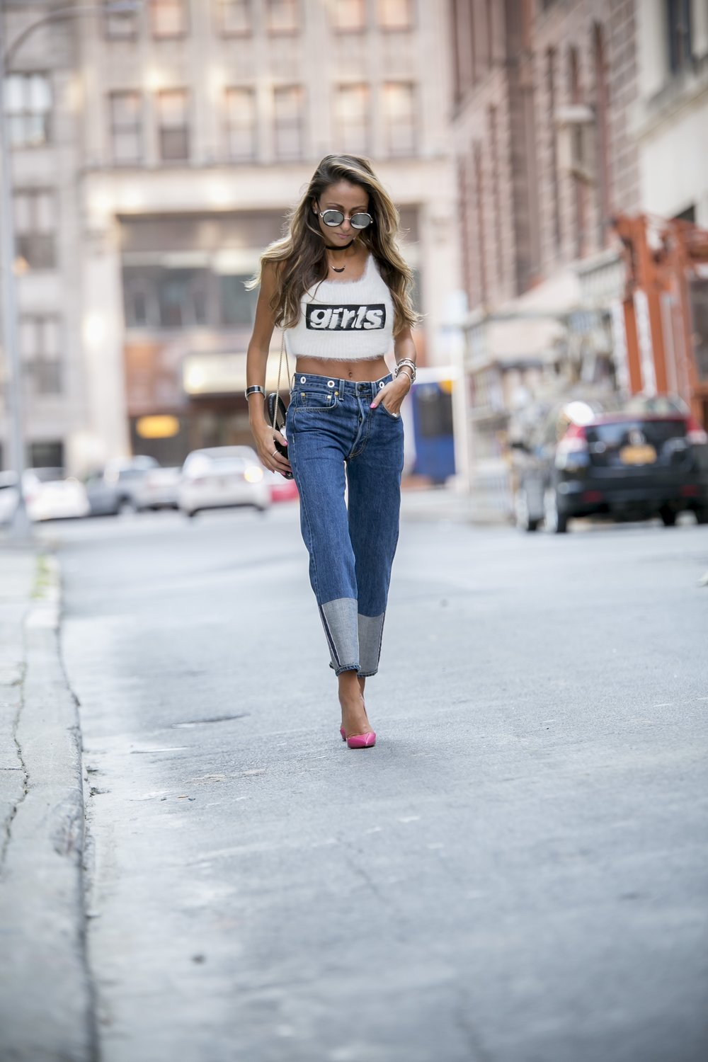 fashion blogger seen in Jimmy Choo sunglasses, Alexander Wang knit girls tank, Rag and Bone jeans, and Christian Louboutin pumps