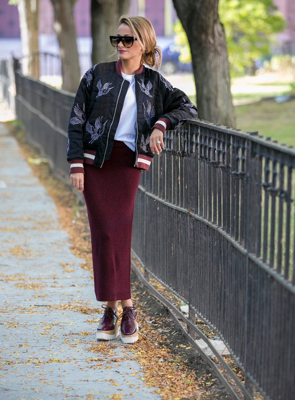 sandro paris bomber jacket worn with maje and Stella Mccartney platforms
