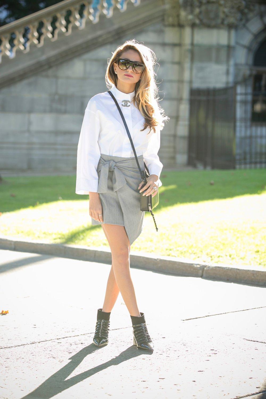 DKNY top, Zara knot skirt, Miu Miu booties, Celine Sunglasses, Rebecca Minkoff bag, and Chanel pin