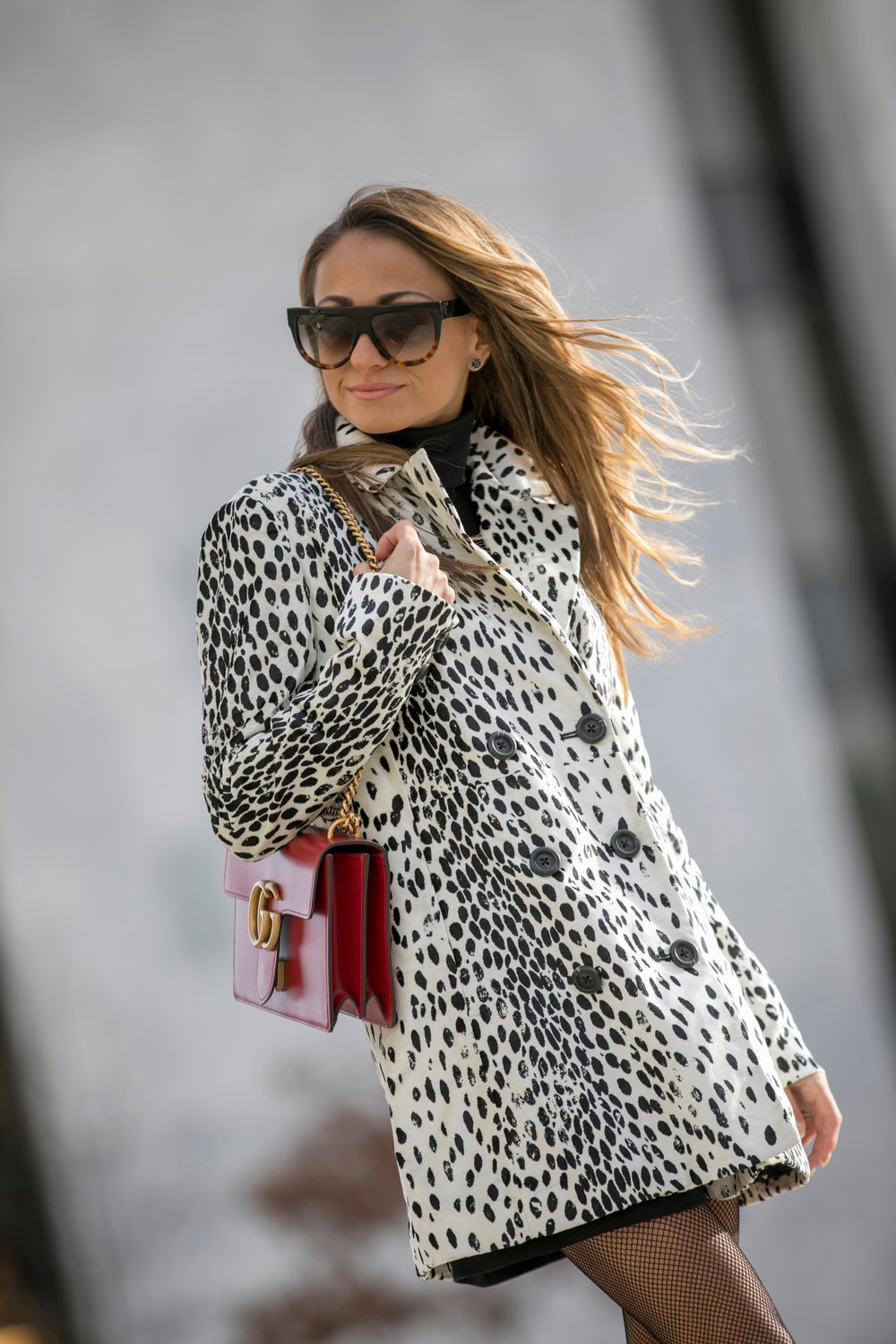 Gucci Marmont bag and gucci booties paired with a leopard free people coat