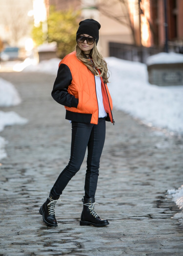 winter streetstyle in a beanie, puffer jacket, and combat boots