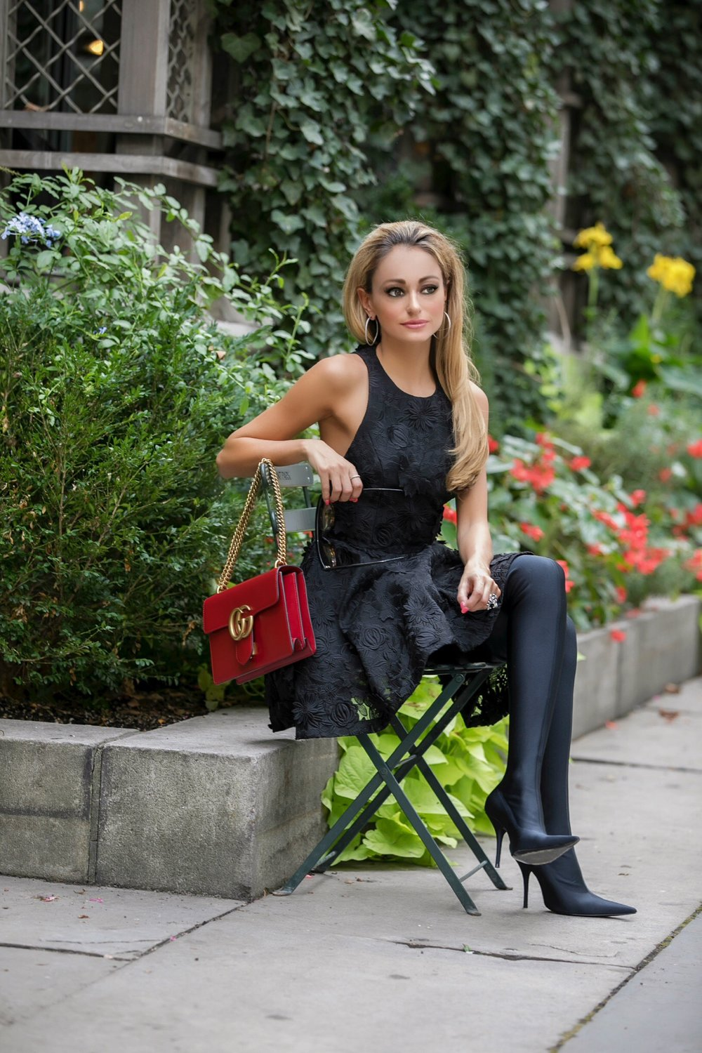 Lauren Recchia in Bryant Park wearing an Alice and Olivia dress, Balenziaga boots, and Gucci bag