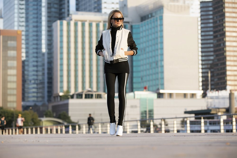 NYC streetstyle in a bomber jacket, stirrup leggings, and Manolo Blahnik booties