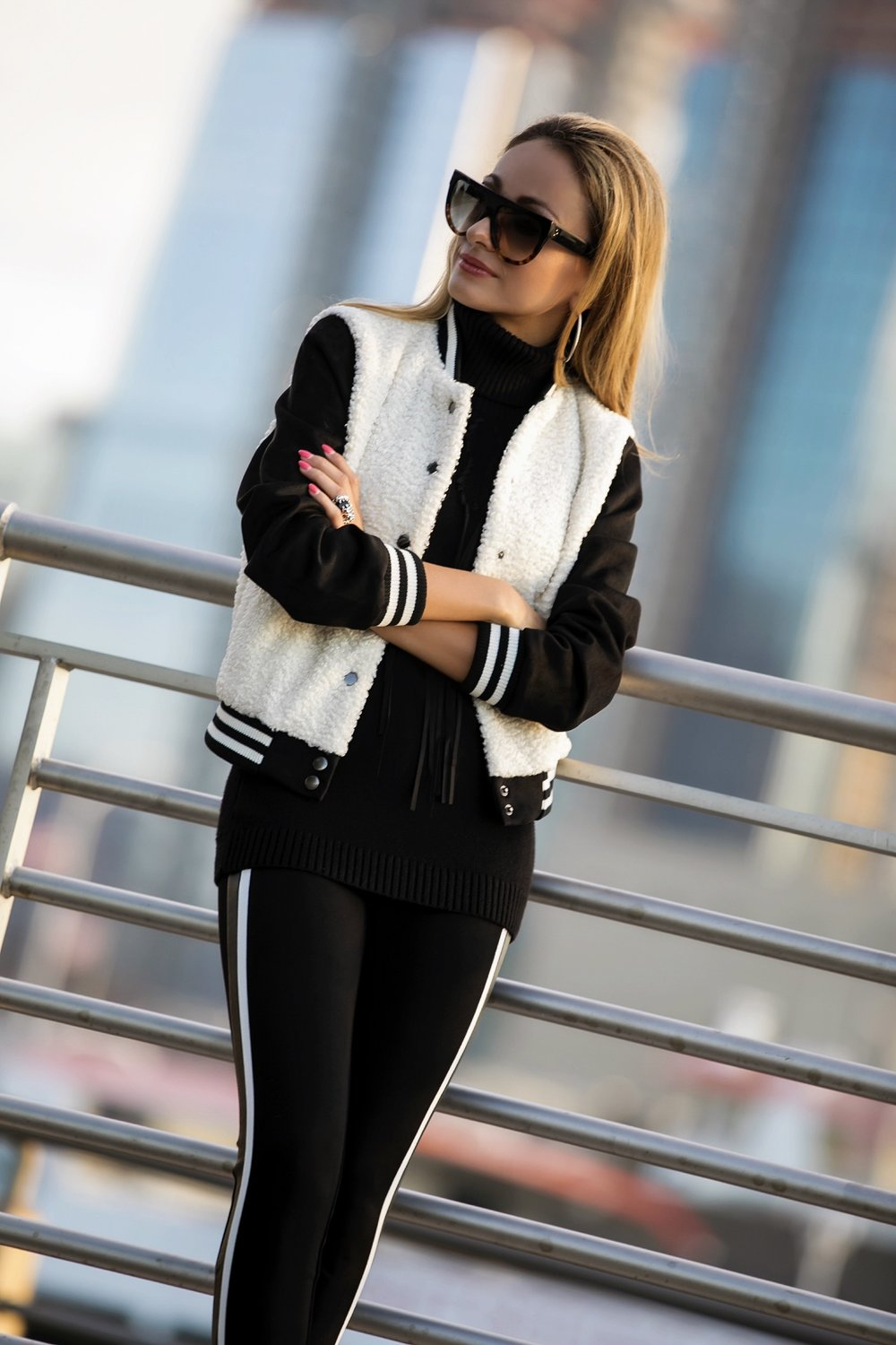 Lauren Recchia in NYC wearing a shearling bomber jacket and stirrup leggings