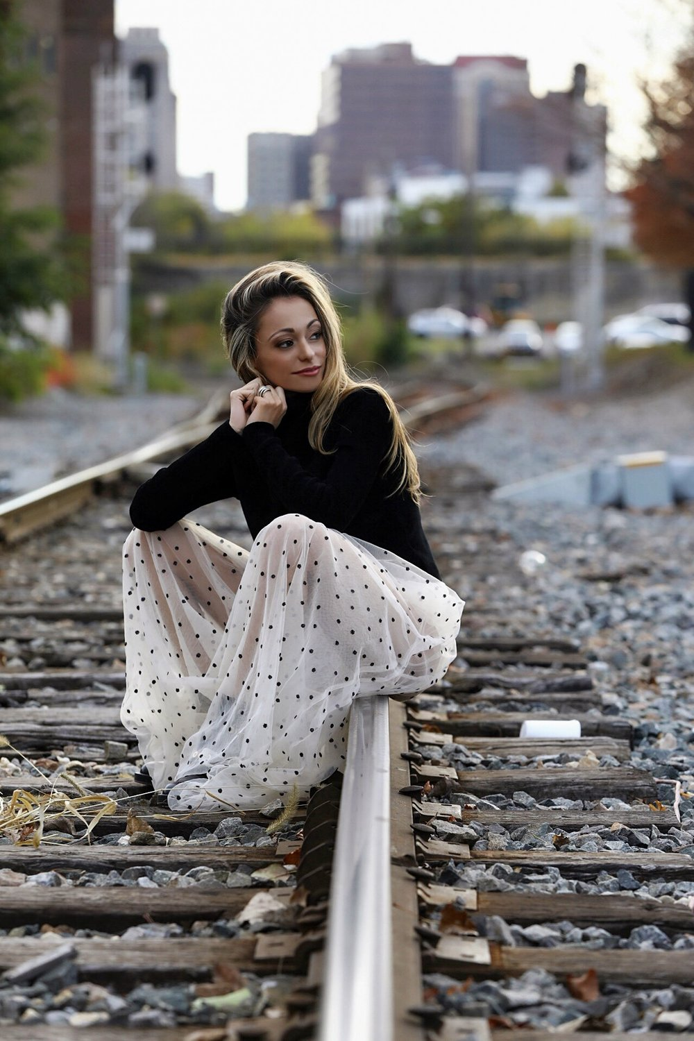 fall fashion in a sheer skirt with black sequin dots and Milly pullover