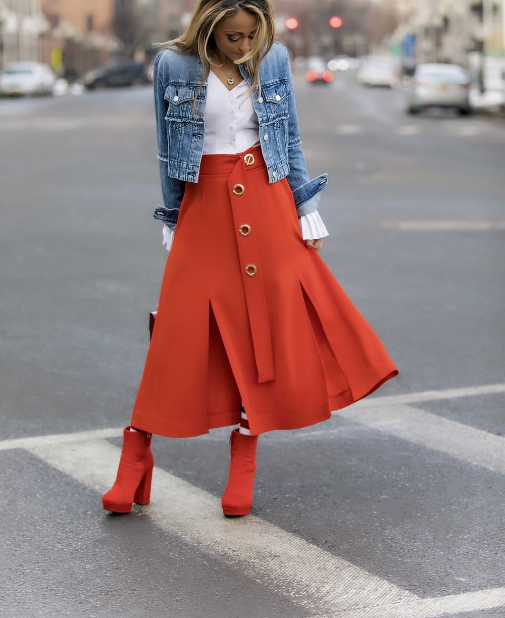 Lauren Recchia fashion week streetstyle in cropped denim and red midi skirt by Derek Lam
