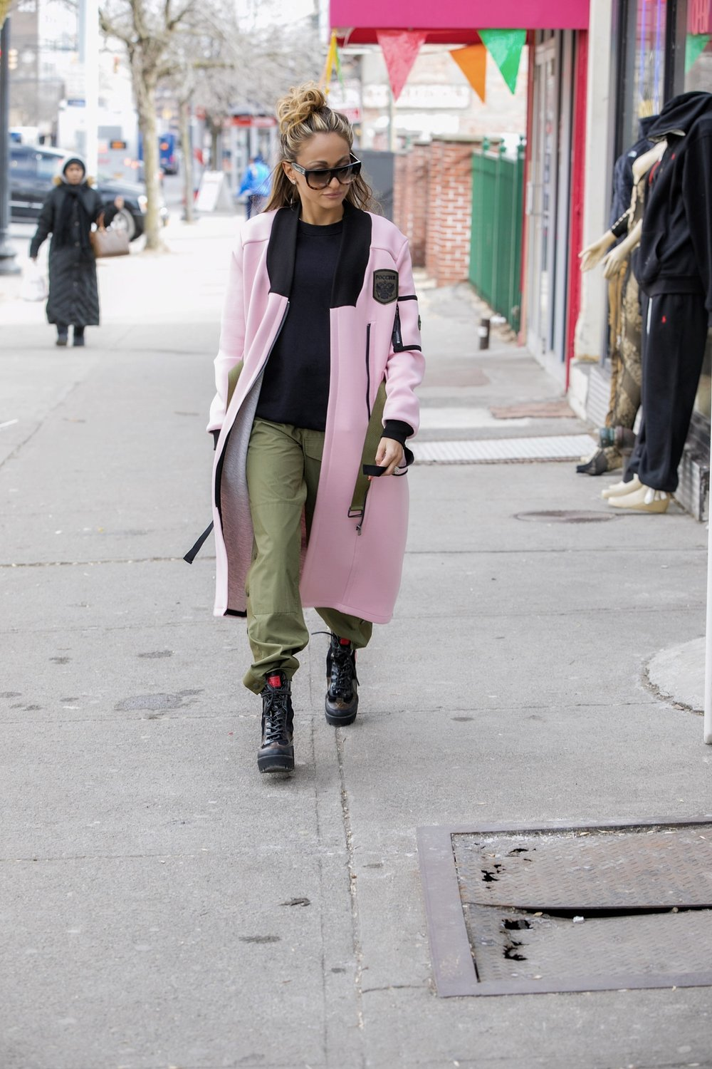 long bomber jacket, rag and bone side snap pants, and Louis Vuitton combat boots