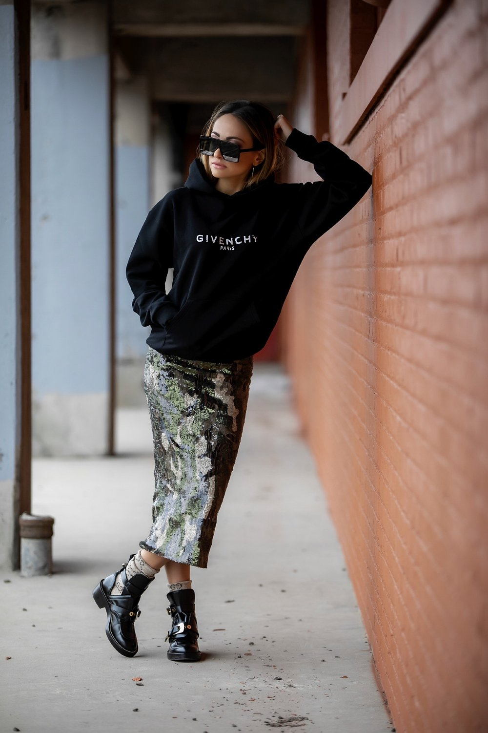 Lauren Recchia nyc streetstyle blogger in Givenchy sweatshirt, Le Superbe sequin skirt, and Balenciaga boots