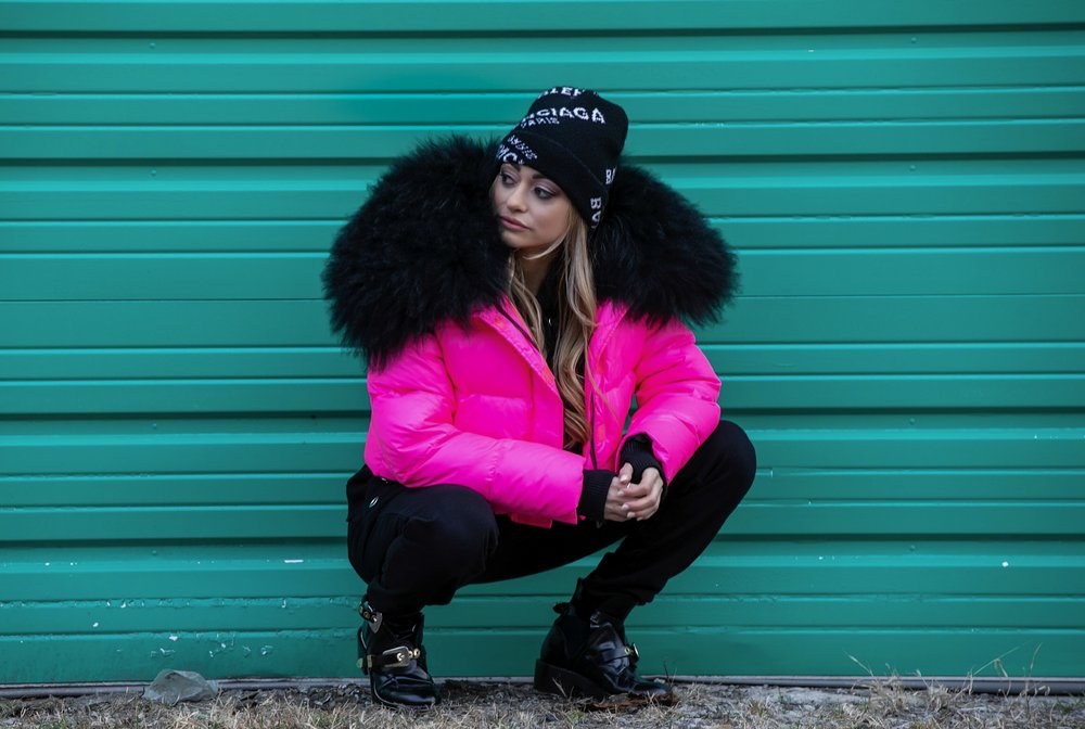 Neon pink puffer jacket and Balenciaga beanie on fashion blogger Lauren Recchia of North of Manhattan