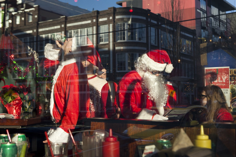 """Hundreds of Santa's gathered at bars onCapital Hill for Seattle's annual""""Santarchy"""" on Saturday, Dec. 13, 2014."""