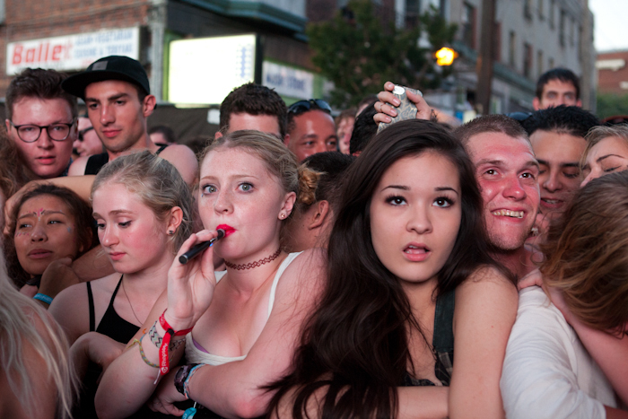Young fans pack themselves tightly together in the front of the crowd as the wait for A$AP Rocky to perform at Capitol Hill Block Party, July 2014.