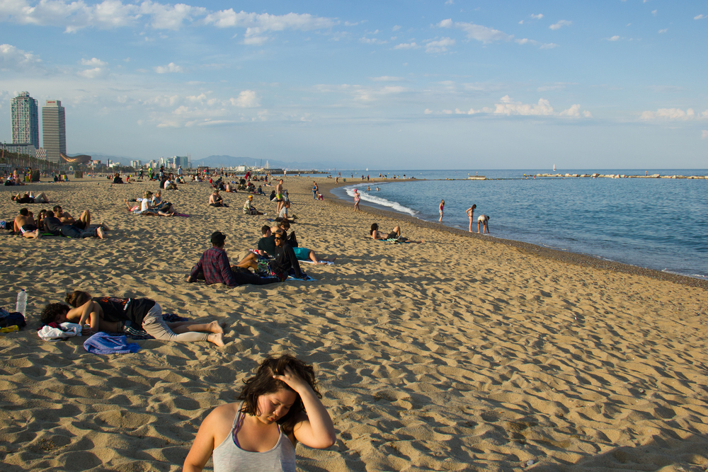 Tourists and Barcelona locals on Barceloneta Beach in June, 2013.