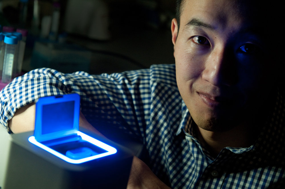 Spartan Bioscience CEO Paul Lem, alongside the company's Spartan Cube DNA tester. Photo by Mark Holleron.