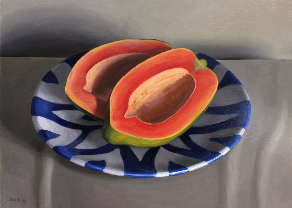Papaya on a Blue and White Dish