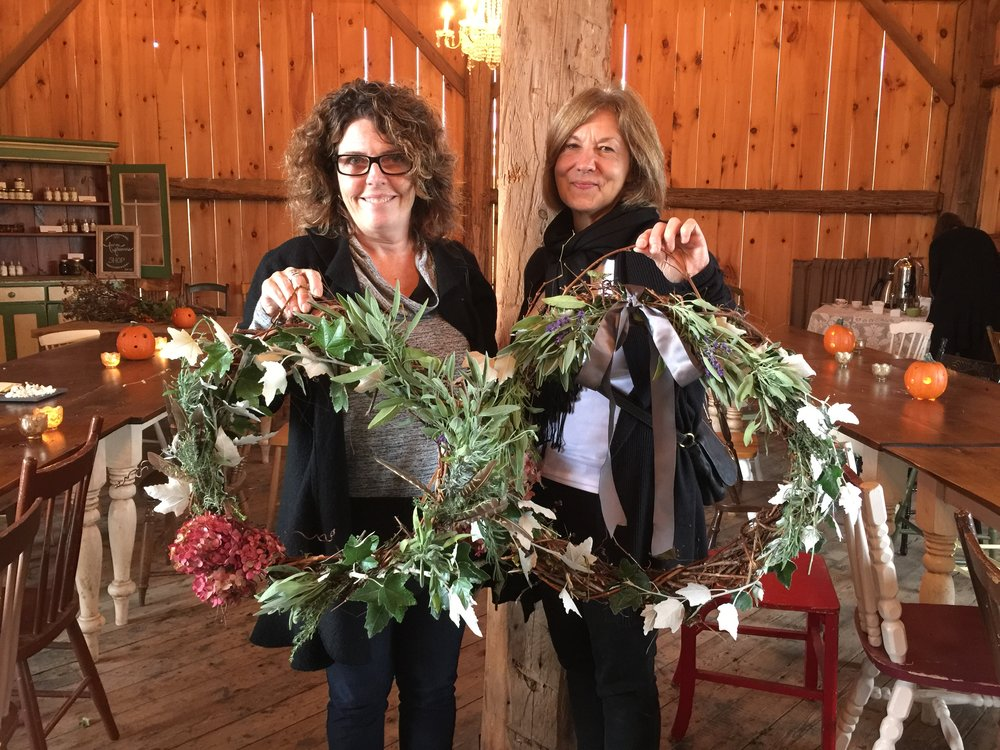 Friends meeting half way to join in wreath making.
