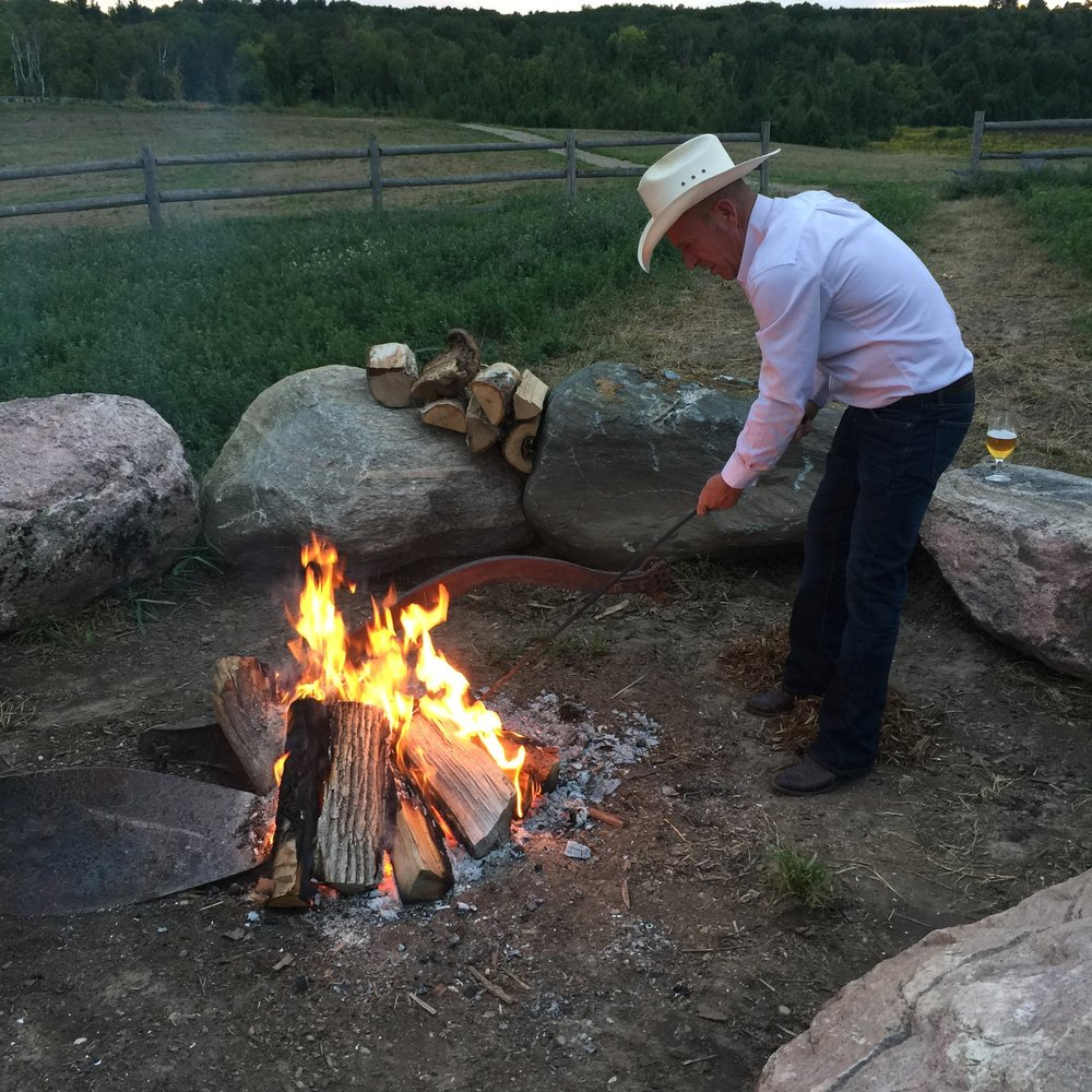 The cowboy tending the fire - summer or winter.