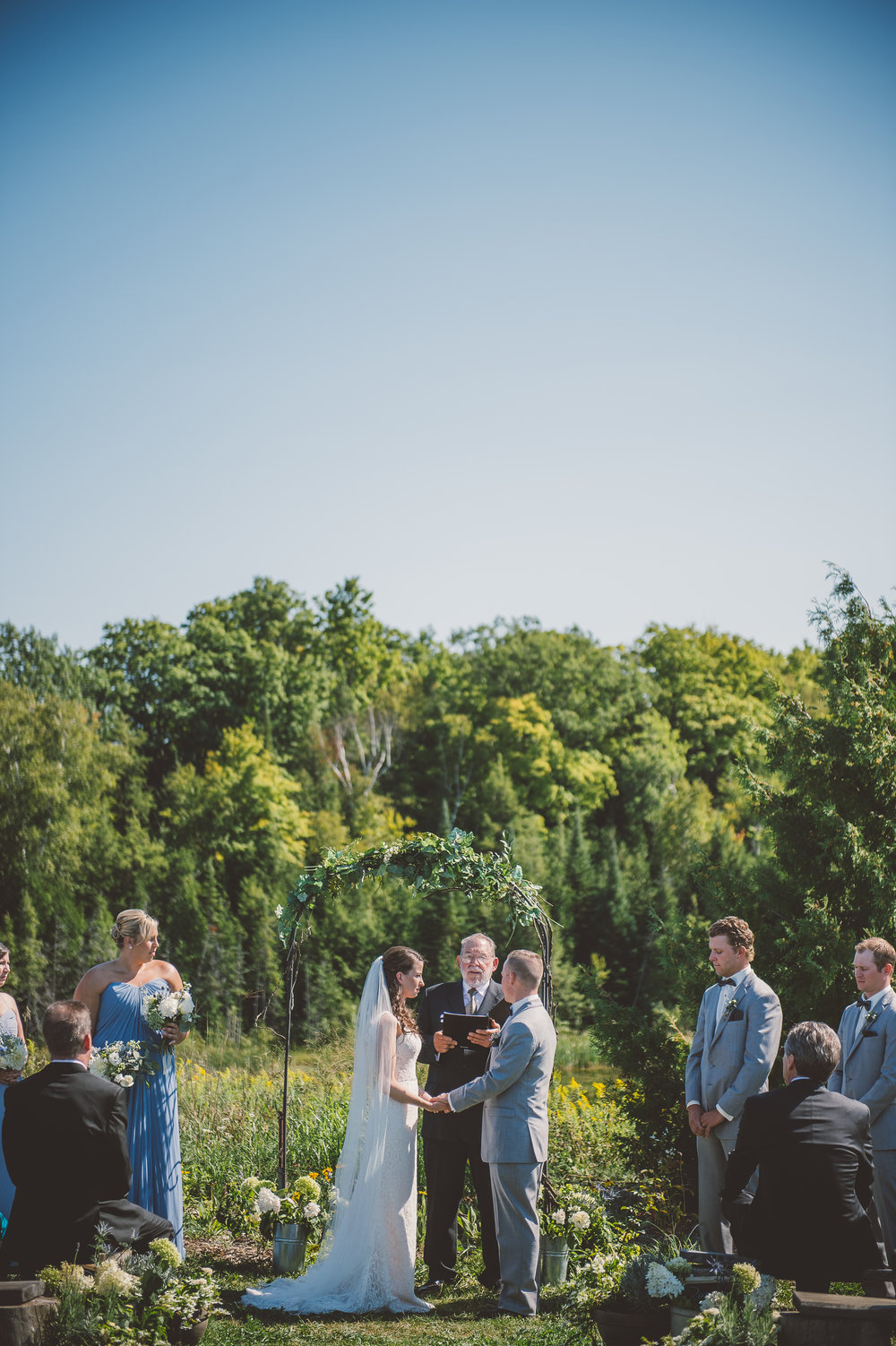 "Christine and Jordan say ""I do"" at South Pond Farms. Photo Credit: Jenn Austin Driver"